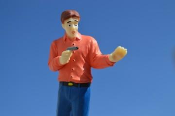 Toy man with toy gun